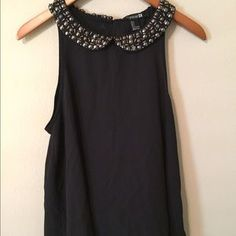 I just discovered this while shopping on Poshmark: Black sleeveless beaded collar. Check it out!  Size: L