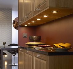 These are really nice under cabinet lights, but I wonder how much space they take inside the cabinet.