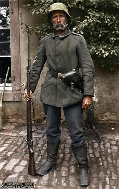 An outstanding outdoors portrait of a seasoned trench raider, this fellow is wearing Fechtabzeichen on his right arm, denoting his prowess with a sabre. He is armed with a Mauser 98 AZ (98a) fitted with an Ersatz knife-bayonet and a Reichsrevolver.  It is probable that this photograph was taken pre-July 1918.
