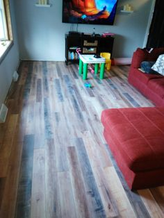 Armstrong Worldly Hue creates a beautiful, rustic look! #Flooring #Laminate #Reclaimed #Barnwood