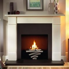 65 Inspiring Fireplace Ideas To Keep You Warm Whether you live in California or Vermont, a cozy fireplace pulls together a home. These fireplace ideas will make you want to light a fire, grab a blanket and cuddle up. Corner Electric Fireplace, Corner Gas Fireplace, Build A Fireplace, Cast Iron Fireplace, Antique Fireplace Mantels, Old Fireplace, Limestone Fireplace, Fireplace Design, Fireplace Ideas