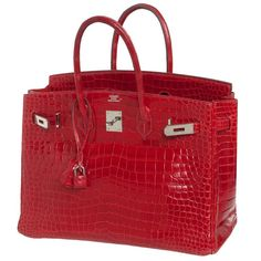 Invest in a classic with this Hermes Birkin, crafted in shiny crocodile Leather in a vibrant braise colour. Lined with a matching goatskin leather, this spaciously sized bag features two interior pockets: one open and one zipped and is accented with Hermes Bags, Hermes Handbags, Hermes Birkin, Purses And Handbags, Suede Tote Bag, Nylon Tote Bags, Chain Crossbody Bag, Leather Hobo Handbags, Handbag Stores
