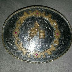 Vintage belt buckle Barrel racer in middle of buckle surrounded by brass design with 4 pink gems. See 2nd pic for better details. Made in Alpaca, Mexico. Not sterling silver, but silver plated on the front of buckle. Accessories Belts