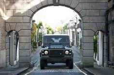 Land Rover Defender 90 Td4 Sw Se autobiography under arch medieval city.