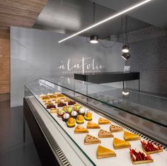 Atelier Moderno together with Anne Sophie Goneau have designed Patisserie À La Folie, a contemporary pastry shop and storefront in Montreal, Canada. Make sure to look at the before photos to see the dramatic transformation.