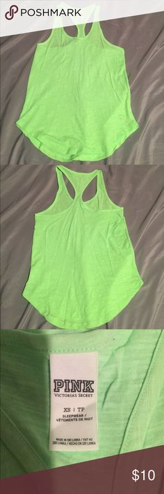 PINK Victoria Secret Racerback Tank XS PINK Victoria Secret Racerback Tank XS Neon Green. Worn twice in great condition. Cotton and Polyester. No trades open to offers ☺️ PINK Victoria's Secret Tops Tank Tops