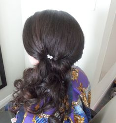 Dark brown curly side pony hairstyle