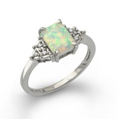 My mom used to let me wear her opal ring. I want one of my own.