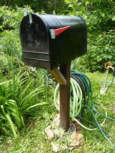 """Mailbox recycle- idea from another pin I often saw here on Pinterest- """"Put a mailbox in your garden to store tools!"""""""