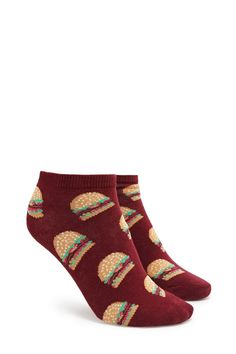 A pair of knit ankle socks featuring a burger print and ribbed trim.