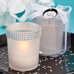 "If you're looking to add some event-day bling, these white candle holders are just the thing   Are you a bling fan? Do you love a lot of sparkle in your day? Well, let Fashioncraft introduce you to this candle stunner. One look and you'll know why it's part of our Bling Collection. And, with its showstopping clear rhinestone clustered border, it has just the right amount of glitz and glam to put you - and your guests - in bling heaven!   Description and details:  •Each measures 2.5"" x 2"" ..."