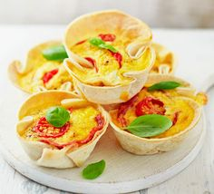 Use tortilla wraps and a muffin tin to make individually portioned egg, salami and tomato bites - ideal for lunch boxes or picnics