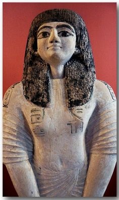 Painted limestone statue of The Scribe Râmès, New Kingdom. On his shoulders are the cartouches of Rameses II and the earlier kings Tuthmose IV and Horemheb. Probably born before Horemheb, Rames was a scribe of the 'Temple of Millions of Years' of Tuthmose IV. Inv.nr. E 16346.  In French (from the website of the Louvre Museum):