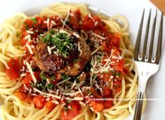Homemade Meatballs make the difference in a plate of Spaghetti. Spaghetti-And-Meatballs by @savorysweetlife