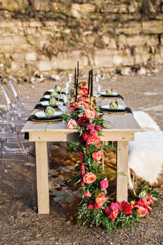 cascading floral table runner - photo by Amilia Photography http://ruffledblog.com/cheery-bohemian-wedding-inspiration-at-a-rock-quarry