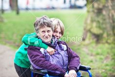 young carer out with his grandmother in a wheelchair Royalty Free Stock Photo