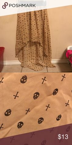 Skirt Skull & cross longish high low skirt, about 33 inches from waist to bottom, very cute & super comfortable! Would fit a size 2-4 or 25, but the waist is stretchy so it could be worn by a 4-6 or 26 as well & still be comfy! Skirts High Low