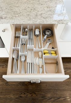 Is the drawer space tight in your kitchen? Not to worry. Drawer dividers can really help you organize small drawers with ease making cooking and baking easier. Some of Neat Little Nest favorites kitchen organizing products are sure to help you go from a mess to an organized success!  #organizingideas #kitcehnorganization #kitchenremodel #kitchendesign #kitchencabinets
