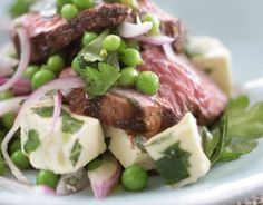 Grilled lamb salad with fresh mint, feta and peas