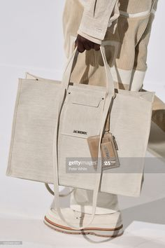 A model, bag detail, walks the runway during the Jacquemus Menswear Fall/Winter show as part of Paris Fashion Week on January 2020 in Paris, France. Get premium, high resolution news photos at Getty Images Backpack Bags, Tote Bags, Uni Bag, Fashion Bags, Fashion Accessories, Sac Week End, Sacs Design, Fabric Bags, Shopper Bag
