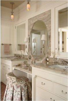 love the use of marble surrounding the mirror