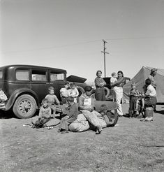 "March 1937. ""Four families, three of them related with 15 children, from the Dust Bowl in Texas in an overnight roadside camp near Calipatria, California."" Photo by Dorothea Lange"