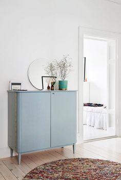 pale blue cabinet in white hallway outside of bedroom / sfgirlbybay