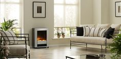 Heat up your home and make an immediate design statement with our Lee Silver Portable Electric Fire. Equipped with castors for the utmost portability, and the Optiflame log effect for real ambience with no troubles! Dimplex Electric Fires, Electric Fireplace Heater, Heat Energy, Living Spaces, Living Room, Home Decor Styles, The Help, Contemporary, Wood
