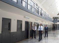 US President Barack Obama, alongside Charles Samuels (R), Bureau of Prisons Director, and Ronald Warlick (L), a correctional officer,…