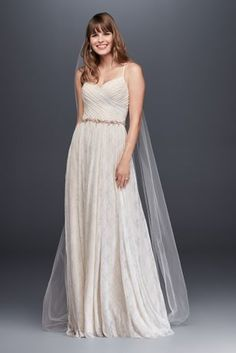 Trending A simple airy lace wedding dress beautifully pleated at the sweetheart bodice before flowing