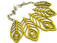 laser cut leather peacock feather necklace in yellow