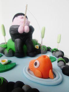 Fisherman cake topper  facebook.com/lousbakinganddecorating