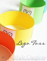Lego Toss--hot glue strips of colored paper to foam board to make different sized circles.  Number the circles with points. Children toss 5-10 Legos into the circles and count their points.