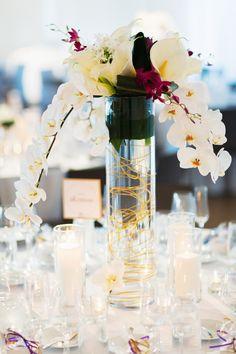 Tall modern wedding centerpiece {Photo by Jonathan Young Weddings via Project Wedding}