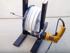 Powered Drain Cleaner by DIY Rex -- Homemade powered drain cleaner constructed from a plastic paint can, surplus lumber, a variable speed drill, rubber wheel, and an off-the-shelf snake auger. http://www.homemadetools.net/homemade-powered-drain-cleaner