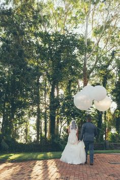 White balloons are a must for a perfect image | Claudia and Jason's beautiful garden ceremony at Eschol Park House | Sydney Wedding Venue