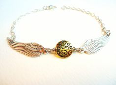 Harry Potter Golden Snitch Bracelet  by ViperCoraraDesigns on Etsy, $10.00. Not really DIY but I have someone in mind for this gift