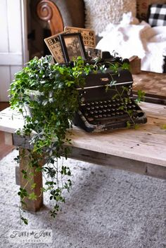 A junk filled summer home decorating tour – Funky Junk Interiors Vinage typewriter plant stand, vintage bingo cards, photos, part of a whole home JUNK tour via Funky Junk Interiors The living area is.