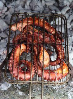 Octopus being grilled over hardwood coals in Kea.