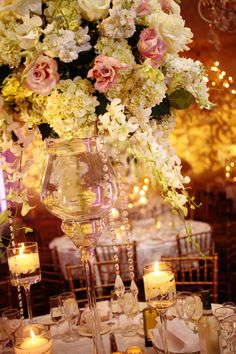 Wedding centerpiece with hydrangea, orchids, roses and hanging crystals. Photo by Brian Ambrose.
