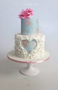 Pretty 2 tier round cake, floral with ruffles and cut out heart