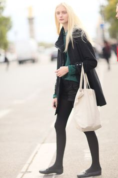 all black with green. Model Nastya Kusakina.