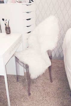 translucent acrylic chairs are so fab for minimal space faux fur