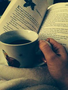 hot drink. handmade mug. good book. warm blanket. comfortable spot. wonderful peacefulness and coziness.