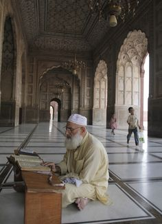 A Pakistani Muslim reads the Quran ahead of Ramadan at the 17th century Badshahi mosque in Lahore, Pakistan, Wednesday, June 17, 2015. Muslims throughout the...