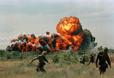 18 of 62 © AP Photo A napalm strike erupts in a fireball near U.S. troops on patrol in South Vietnam in 1966.