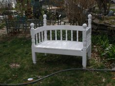 Bench made from a discarded twin bed frame.