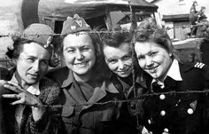 Four Polish insurgents of the Polish Home Army (Polish: Armia Krajowa) who were captured by Germans after the failed Warsaw Uprising are photographed through barbed wire at Stalag VI-C POW camp after their liberation. Following the German suppression of the Warsaw Uprising, Stalag VI-C became the only POW camp in Nazi-occupied Europe which held female combatants as prisoners of war and not merely as inmates. The camp was finally liberated on 12 April 1945 by the Polish 1st Armoured ...
