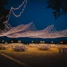 Outdoor ancient ruin nuptials with a floral arch of dreams followed by a wedding breakfast under a spectacular canopy of fairy lights