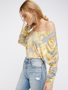 We The Free Analisi Top   In a super soft and stretchy fabric this printed top features dolman style sleeves with ruched detailing. With a wide neck this versatile top can be worn off-the-shoulder.